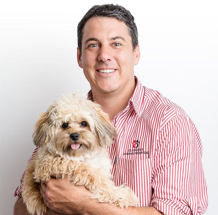 Illawarra Vet Holding a Dog